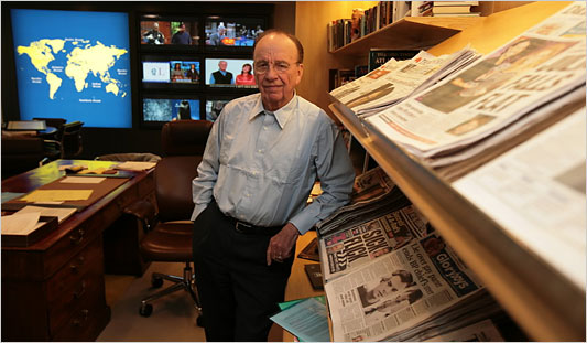 Murdoch with his in-office library. Via  NY Times