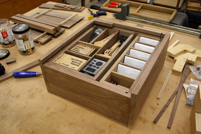 "Semigood's Venue Box, ""a handcrafted walnut box for storing equipment and road trip ephemera that transforms into a bare-bones recording base"""