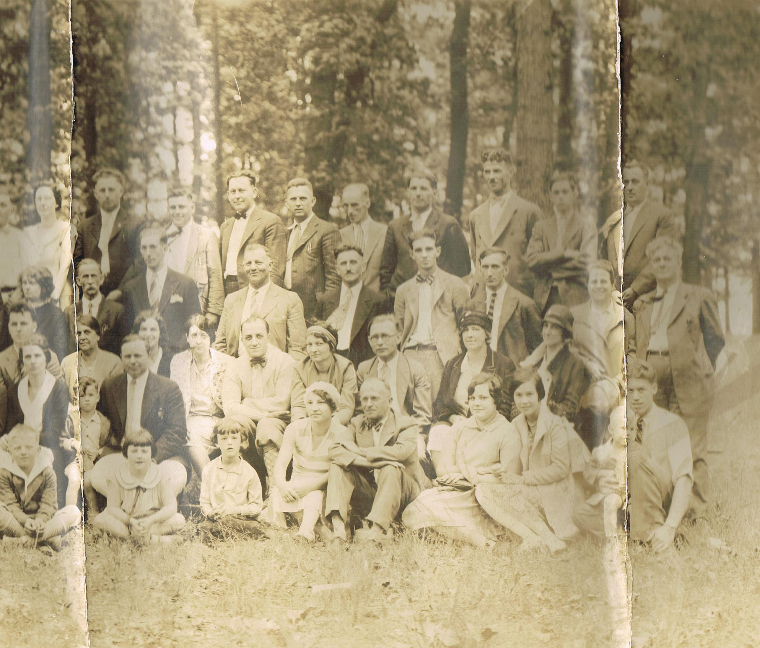Picnic, 1929. My grandmother is in the bottom row, second adult from the right.