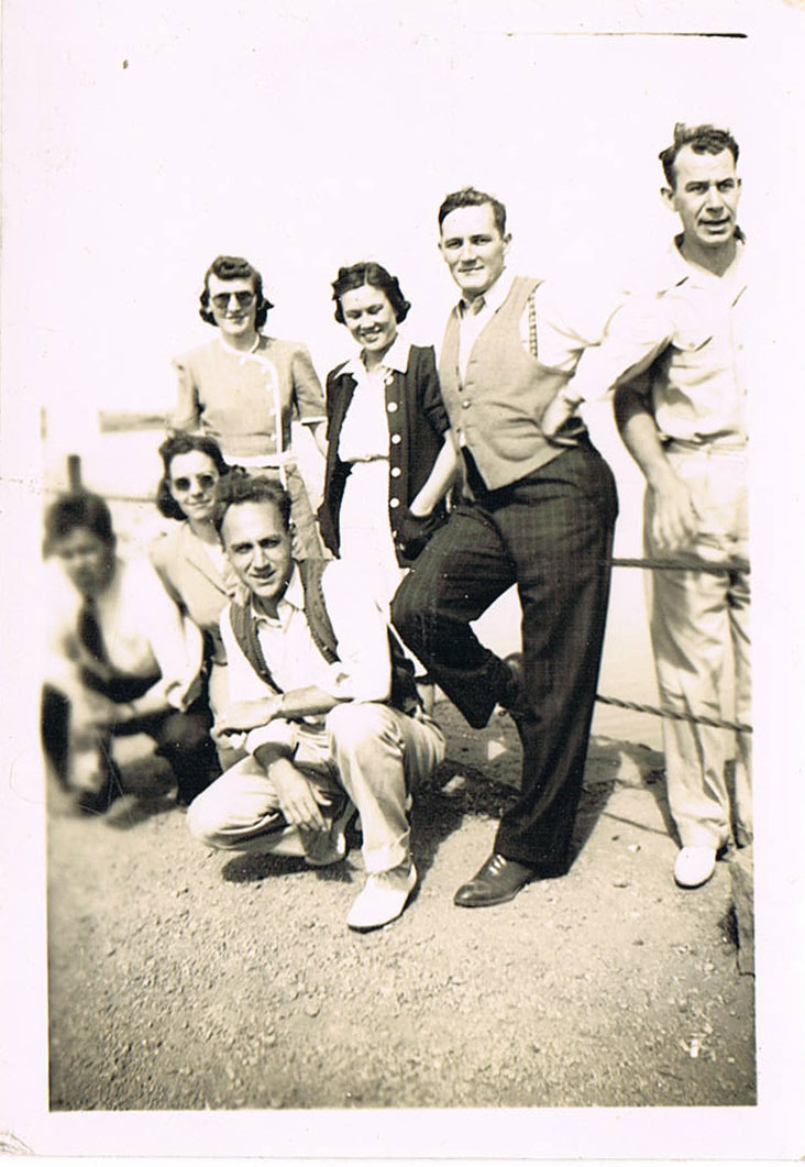My grandmother is in the middle, in the white dress and black cardigan; my grandfather is beside her, in the pinstriped pants.